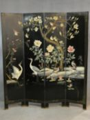 A Japanese black lacquered three fold four panel floor standing screen painted with all over bird