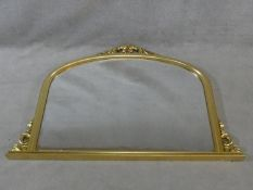 A Victorian style gilt framed overmantel mirror with scrolling foliate cresting. H.91 W.128cm