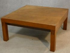 A 1960's vintage teak coffee table on block supports. H.31 L.66 W.66cm