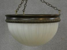A vintage ceiling pendant light shade with bronze metal frame and opaque fluted glass globe. D.37cm