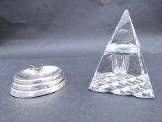 An antique cut glass and brass pyramidal ink well along with a weighted silver ashtray. Hallmarked: