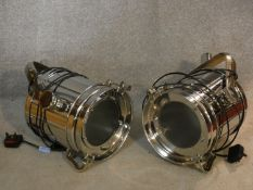 A pair of vintage style theatre spotlights in chromium cases. H.40 W.24cm