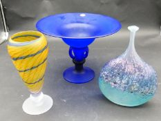 A collection of studio glass. Including a blue glass 'SHEREKAT' pedestal bowl, an onion shaped