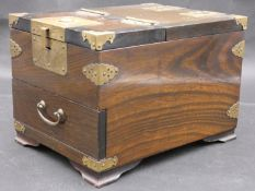 A Japanese brass bound jewellery casket with fitted sliding dressing mirror and carrying handles.