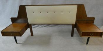 A mid century vintage teak G-Plan headboard with integral bedside cabinets with Ebenezer Gomme