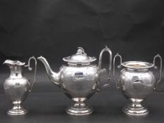 An antique silver plated engraved Roman style three piece coffee set. Each piece engraved wit a