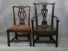 A Georgian country elm Chippendale style armchair with panel seat on square stretchered supports and