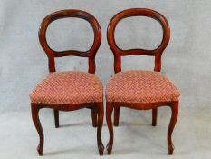 A pair of Victorian style mahogany balloon back chairs on cabriole supports. H.94cm