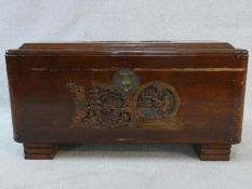 A mid century Chinese carved camphorwood trunk with inset carved carrying handles. H.41 W.77 D.37cm