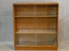 A vintage teak bookcase with sliding glass doors. H.75 W.68 D.27cm