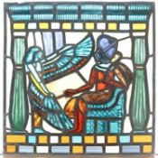 An Egyptian Revival period panel of leaded and stained colored glass. Depicting a Pharaoh being