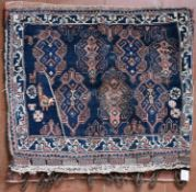 An antique Balouch saddle bag with repeating stylised floral design on midnight ground. L.72xW.65cm