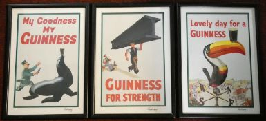 A set of three framed and glazed and signed Gilroy Guinness advertising prints. L.31 W.22cm