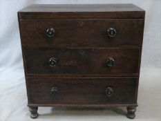 A 19th century faux mahogany painted pine chest of three drawers on turned tapering supports. H.90