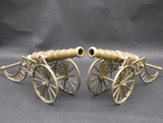 A pair of large table models of field canons with brass barrels and carriages. H.40 L.41 W.11cm