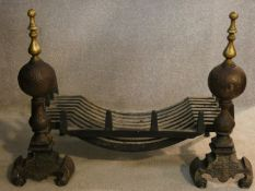 A 19th century cast iron fire grate and fire dogs with brass finials on scroll feet. H.52 W.75 D.