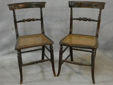 A pair of Regency faux rosewood bedroom chairs each with complementary carved back rails on ring