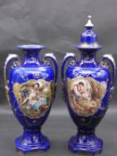 A pair of 19th century blue glazed and gilt highlighted twin handled vases with transfer printed