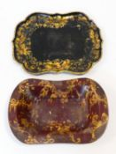 A 19th century black lacquered papier mache tray with gilt floral painted decoration and a similar