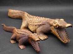 Two carved wooden alligator figures. H.17 L.78cm (largest)
