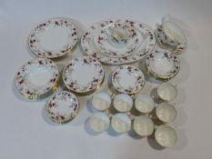 A Mintons Ancestral pattern hand painted porcelain part dinner service, five dinner plates, side