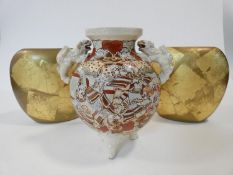 A vintage Satsuma ware lamp base with hand painted Japanese warriors and Foo dog handles, along with