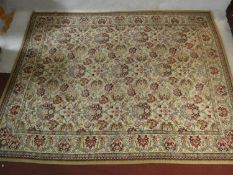 An Eastern style carpet with repeating floral pattern across the field within complementary borders.