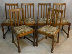 A set of six early 20th century antique style oak dining chairs with drop in seats on turned