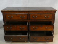 A Georgian oak and mahogany crossbanded mule chest with hinged lid revealing shallow compartment
