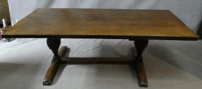 An antique country oak refectory planked top dining table on carved bulbous supports on