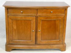 A Willis and Gambier French provincial style chestnut side cabinet of bowed outline fitted with