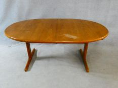 A 1960's vintage teak extending dining table on trestle style supports with extra leaf. H.72 L.167