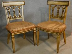 A pair of painted and gilt Continental bar back salon chairs with flechette lattice backs above