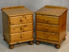 A pair of Victorian style pine three drawer bedside chests. H.62 W.46 D.45cm