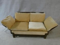 A mid century vintage teak framed Parker Knoll day bed with fully adjustable arms to each end. H.