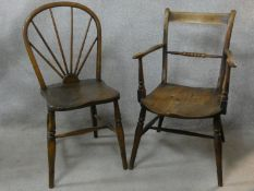 A 19th century beech framed armchair with moulded elm seat and a similar dining chair. H.83cm
