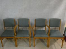 A set of four Gordon Russell beech framed dining chairs stamped Russell of Broadway to include two
