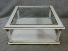 A contemporary white lacquered two tier coffee table with inset plate glass top. H.42 L.100 W.100cm