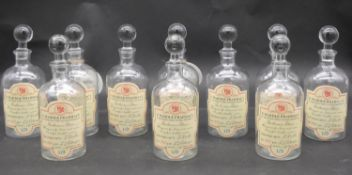 Ten vintage style apothecary's jars and stoppers. H.22cm