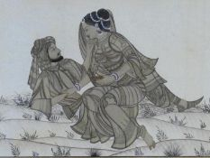 A framed and glazed antique Indo-Persian silk painting of a young couple in love, with gilded