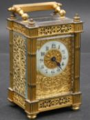 A C.1900 gilt brass cased carriage clock with white enamel dial and Arabic numerals with pierced