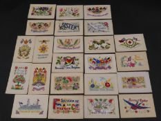 A collection of twenty three silk hand embroidered WW1 souvenir postcards. Some as envelopes with