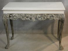 A mid century Beresford and Hicks painted console table in the William Kent style with carved