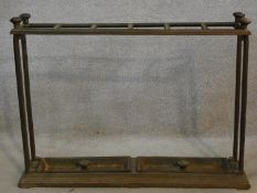 A 19th century cast iron stick and umbrella stand with six sections and lift out drip trays to the