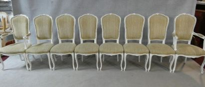 A set of eight Louis XV style distressed painted and gilt dining chairs in fawn upholstery on