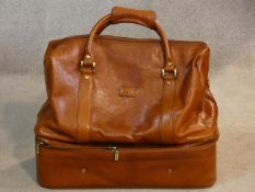 An Italian leather bag with zipped compartment to the base handmade by Condotti. H.40 L.48 W.24cm