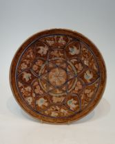 A Persian glazed ceramic lustre plate decorated with birds, fish and flowers. H.30cm