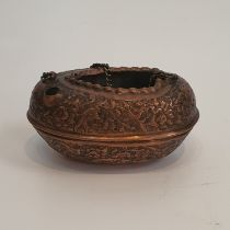 A Qajar copper repousse work Kashkol engraved with darvish, flowers and birds. H.6xW.12cm