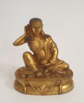 A 19th century Tibetan Milaraspa gilded bronze Buddha statue. H.15xW.13cm