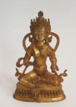 A 19th Tibetan century gilded bronze Buddha sitting on a lotus flower base. H.23xW.15cm